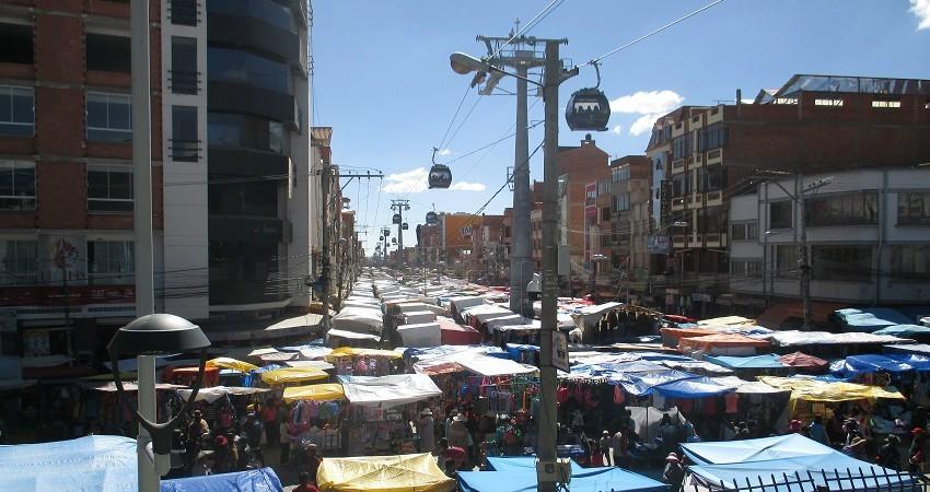Menschenrechte in Bolivien: Wirtschaftlich geht es der Stadt schon besser. Jetzt muss etwas für die soziale Infrastruktur getan werden. Hier ein Blick auf den größten Markt der Welt!